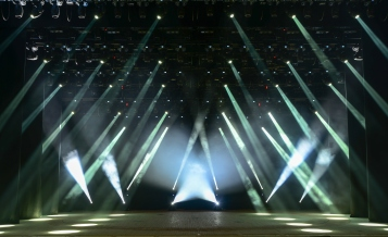 Illuminated empty concert stage with smoke and rays of light